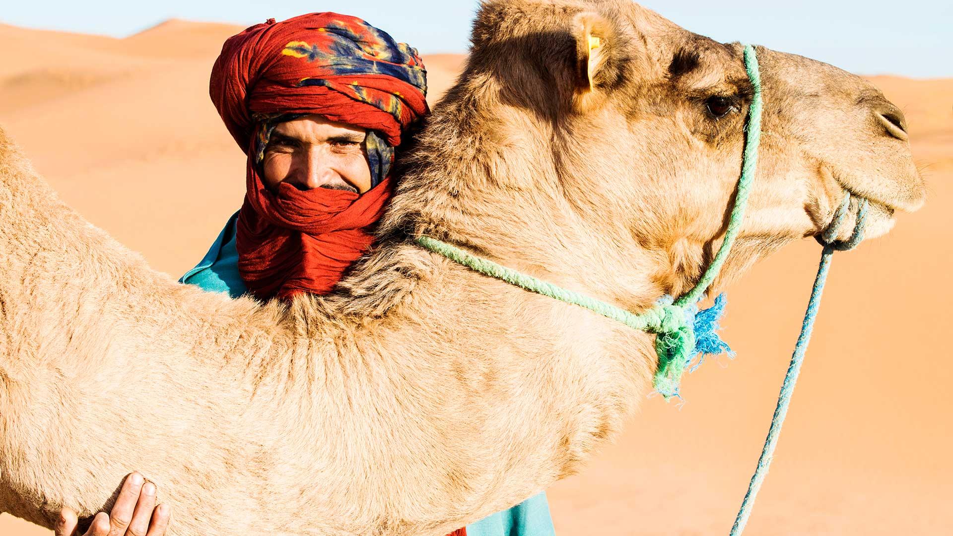 Berber man and a camel, Sahara desert