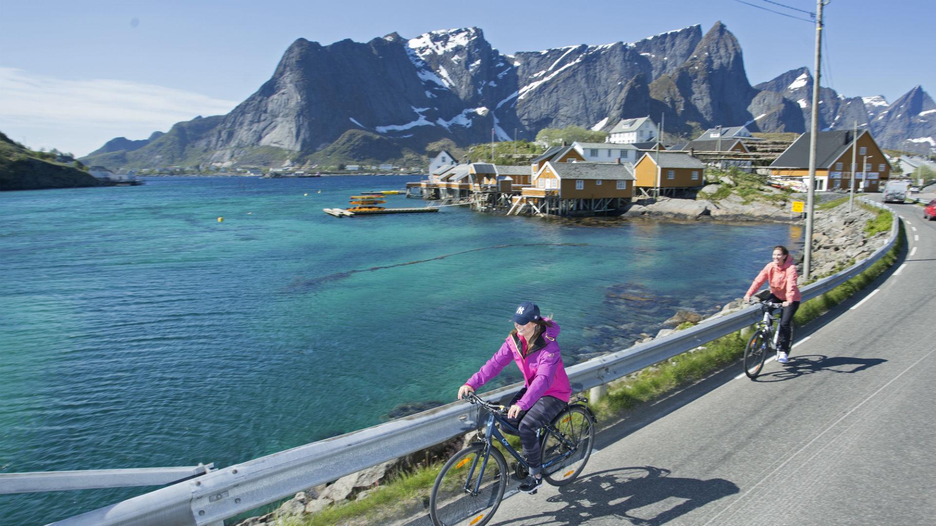 Family bike ride along waterfront