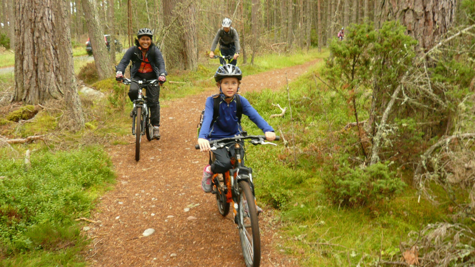 Family biking in Scotland