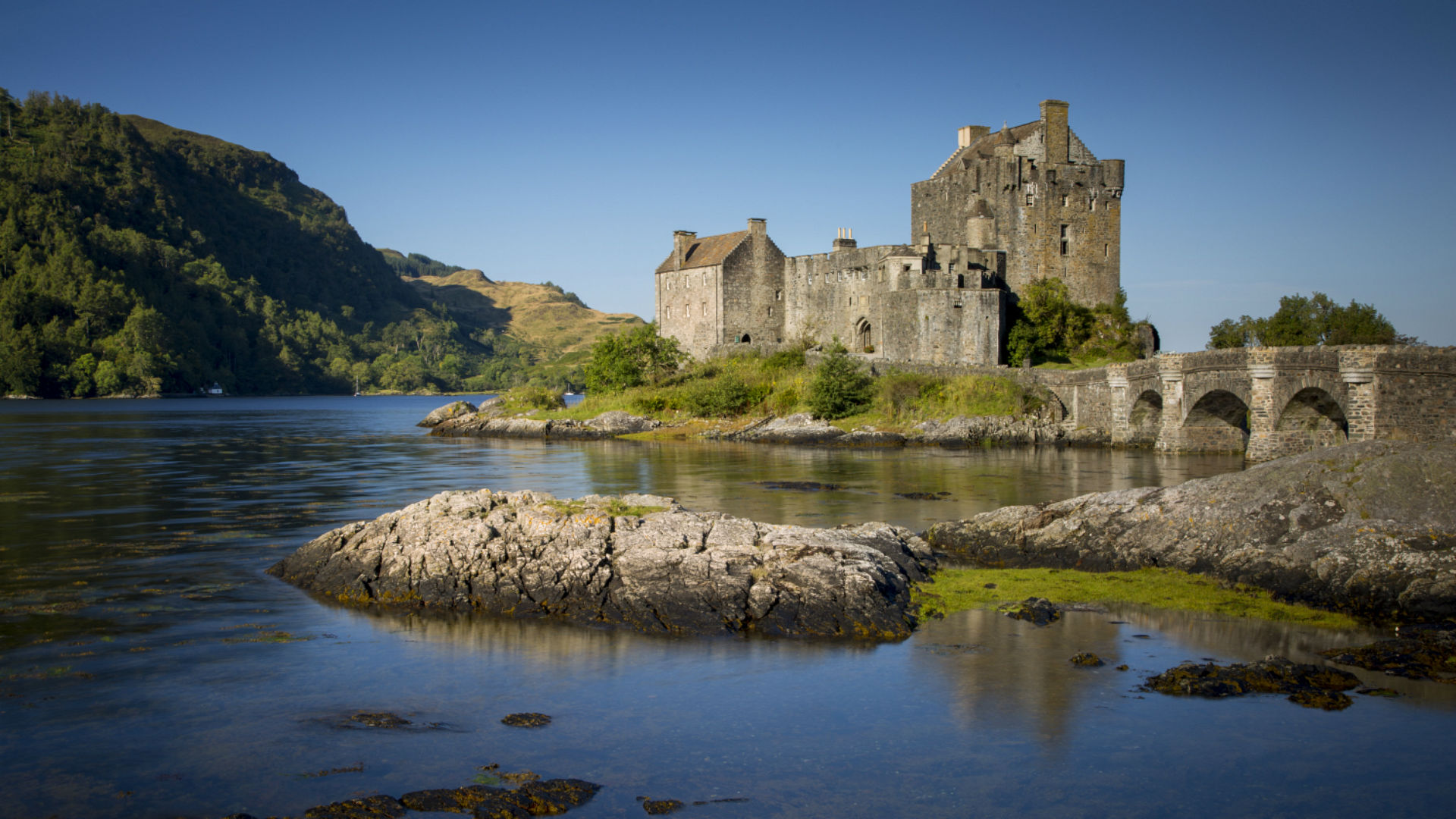 Early morning over Eilean Donan Castle along Loch Duich, Dornie, Highlands, Scotland