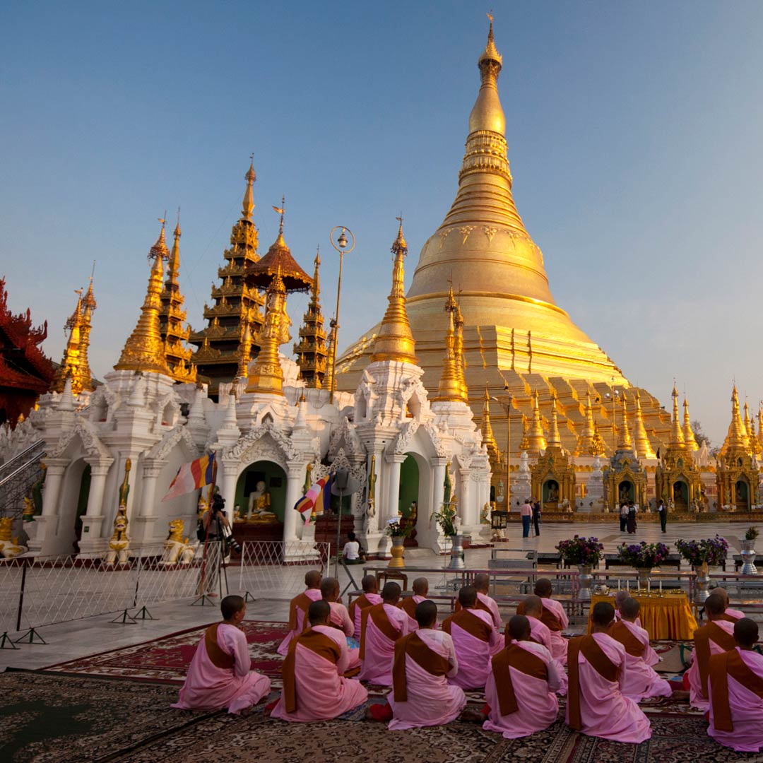Nuns pray at the Shwedagon Pagoda, Yangon, Myanmar