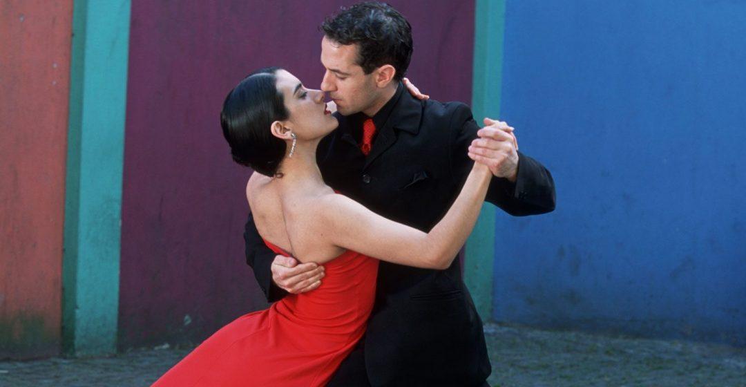 Dancing the Tango amid colorful walls of La Bocoa barrio, Buenos Aires, Argentina