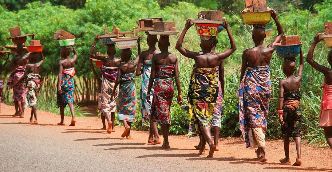 Women walking along road near Cotonou, Benin