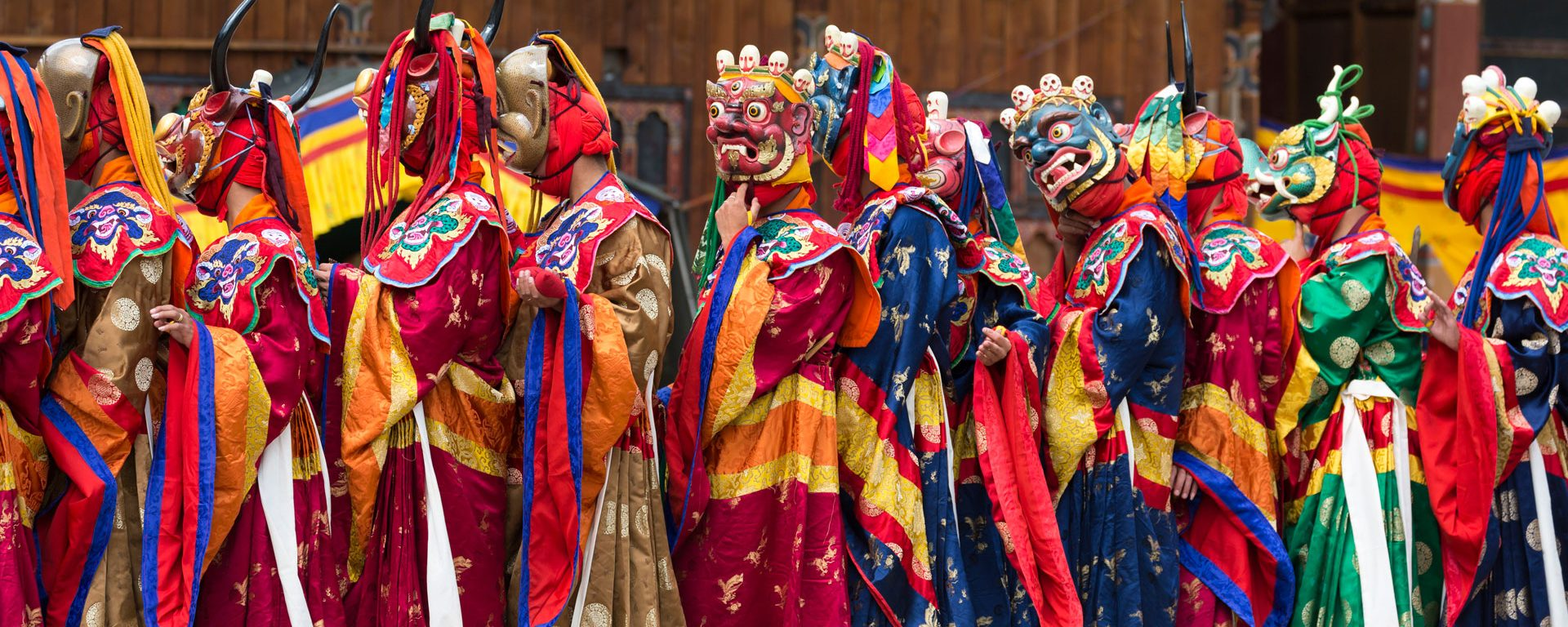 Masked dancers performing 'The Dance of the 16 Drum Beaters from Dramitse', at the Haa Tshechu, Bhutan