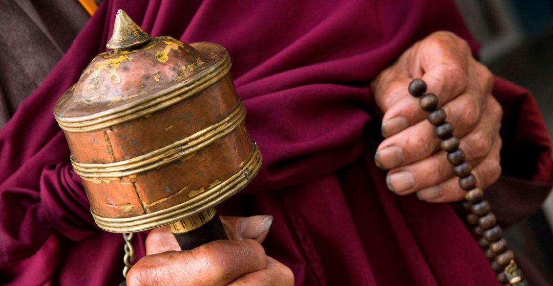 Hands of old monk holding prayer wheel and beads, Rangjung Monastery, Trashigang, Eastern Bhutan