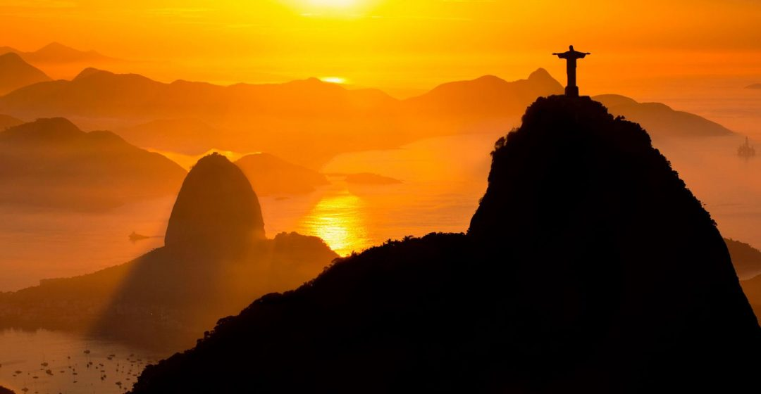 Rio de Janeiro landmarks: Christ the Redeemer and Sugar Loaf in the mist at sunrise, Brazil