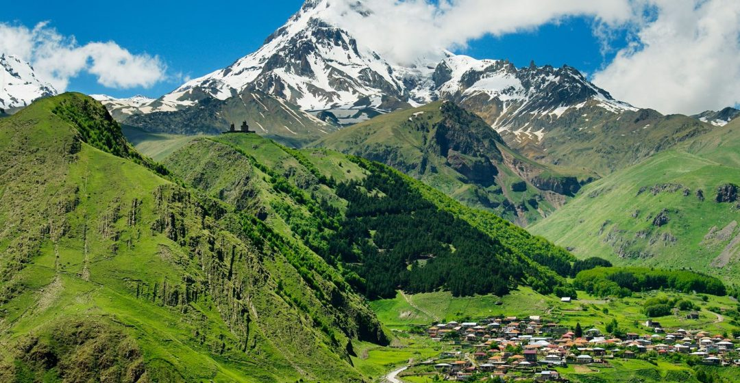 Mount Kazbek and the village of Stepantsminda in Georgia, Caucasus