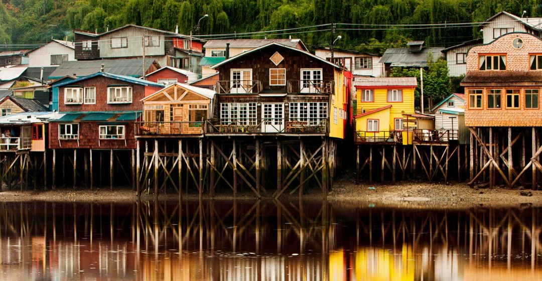 Palafito stilt houses in the tidal bay at Chiloe, Patagonia, Chile