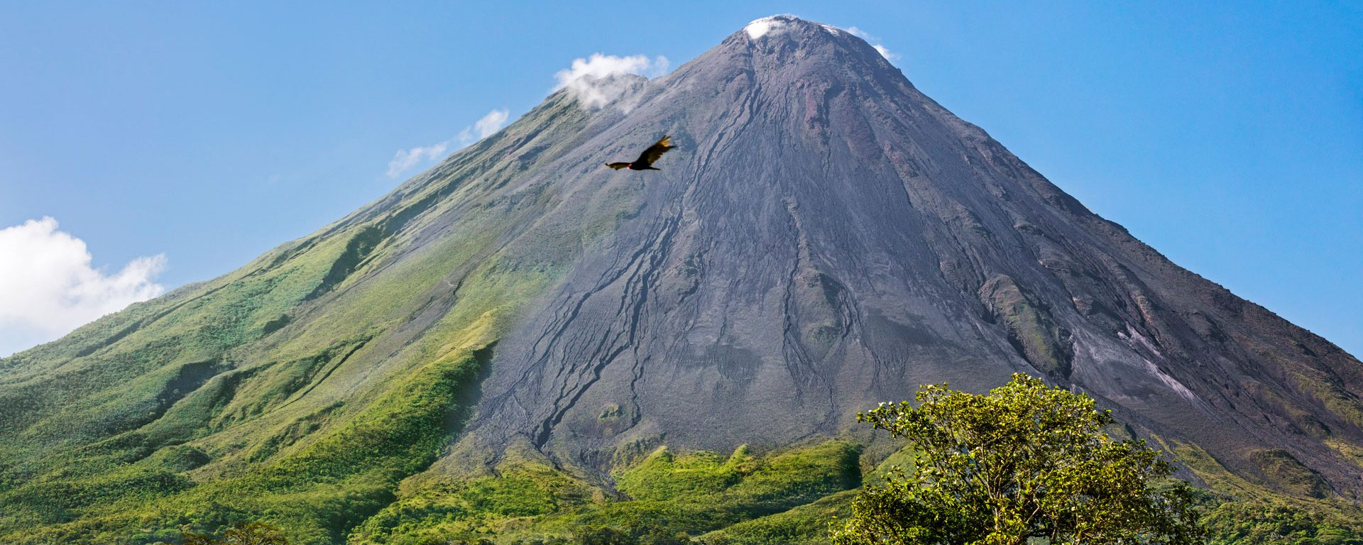 Arenal Volcano with steam rising from its peak, Alajuela Province, Arenal, Costa Rica