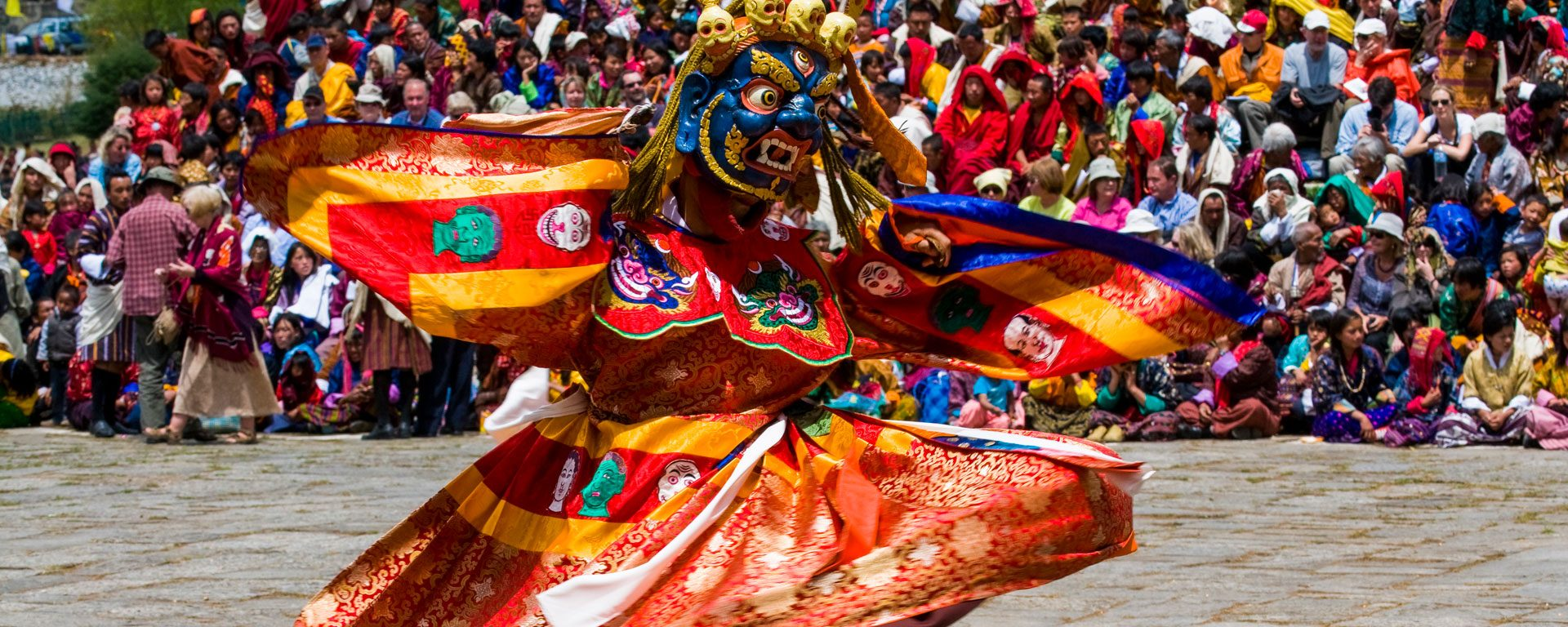 Costumed dancer at Paro Tsechu festival in Paro, Bhutan