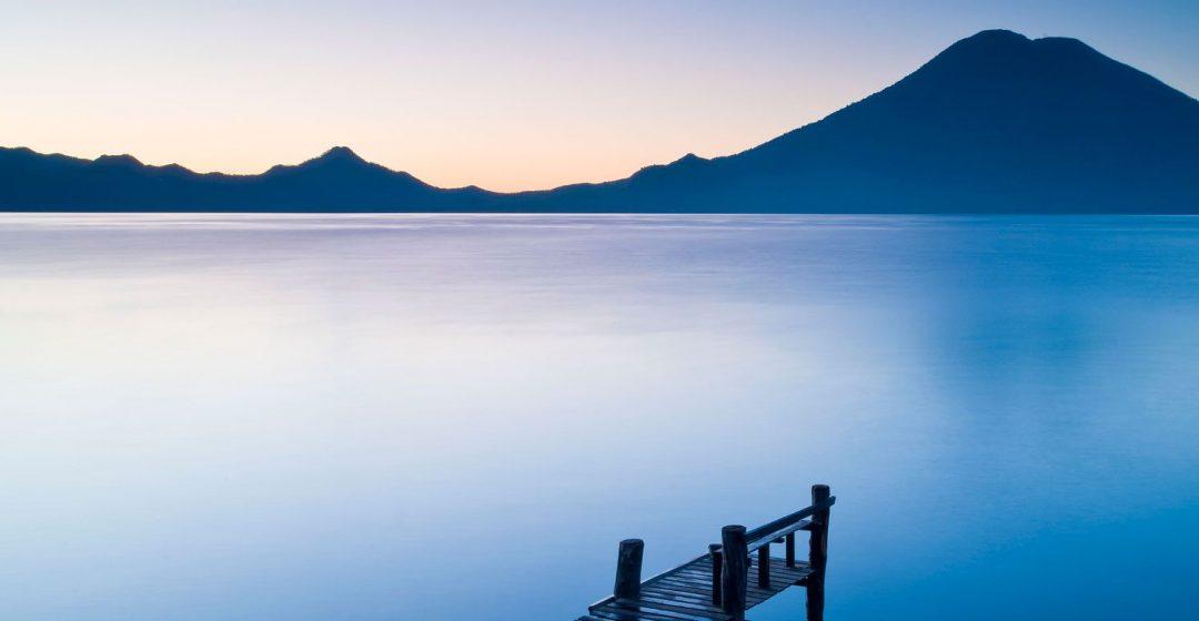 A wooden pier over Santa Cruz La Laguna, with mountain in the background, Lake Atitlan, Guatemala