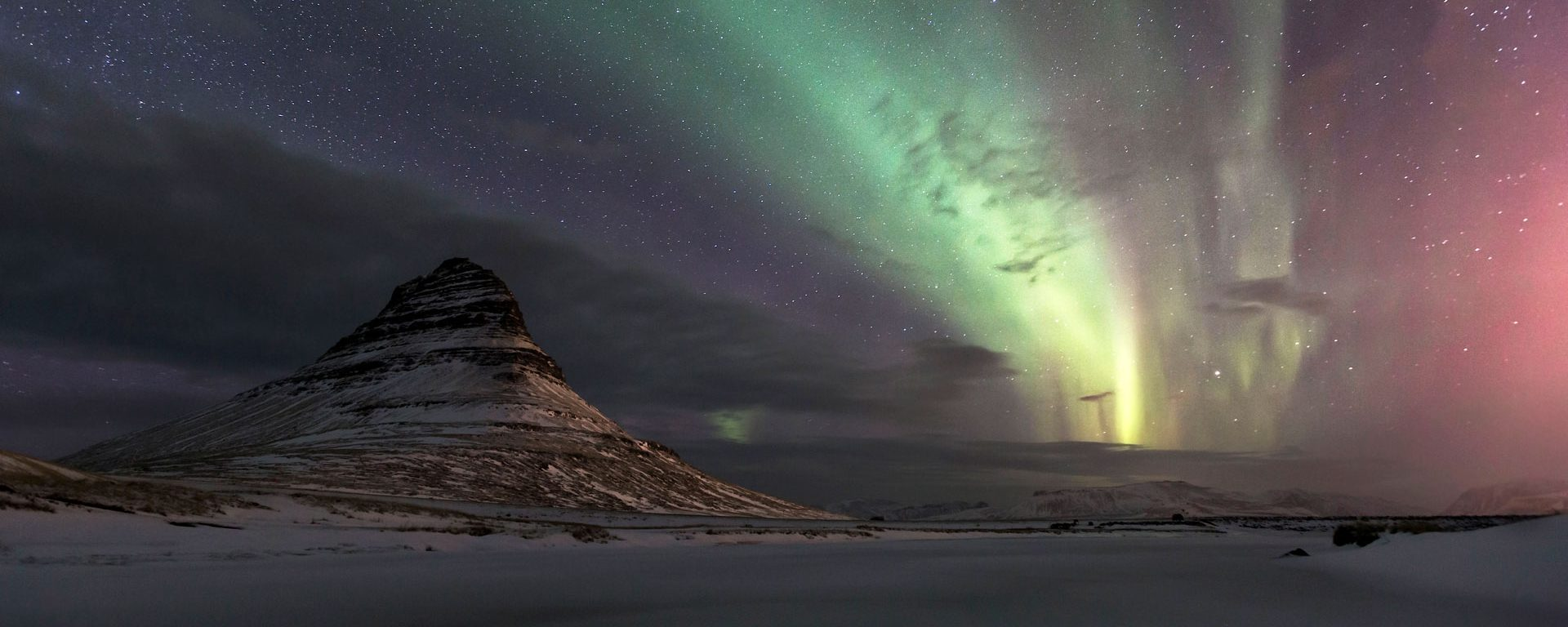 Northern lights above Kirkjufell mountain in western Iceland