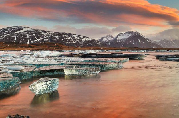 Iceland, South Iceland, Ice on the lagoon reflecting the colors of dawn