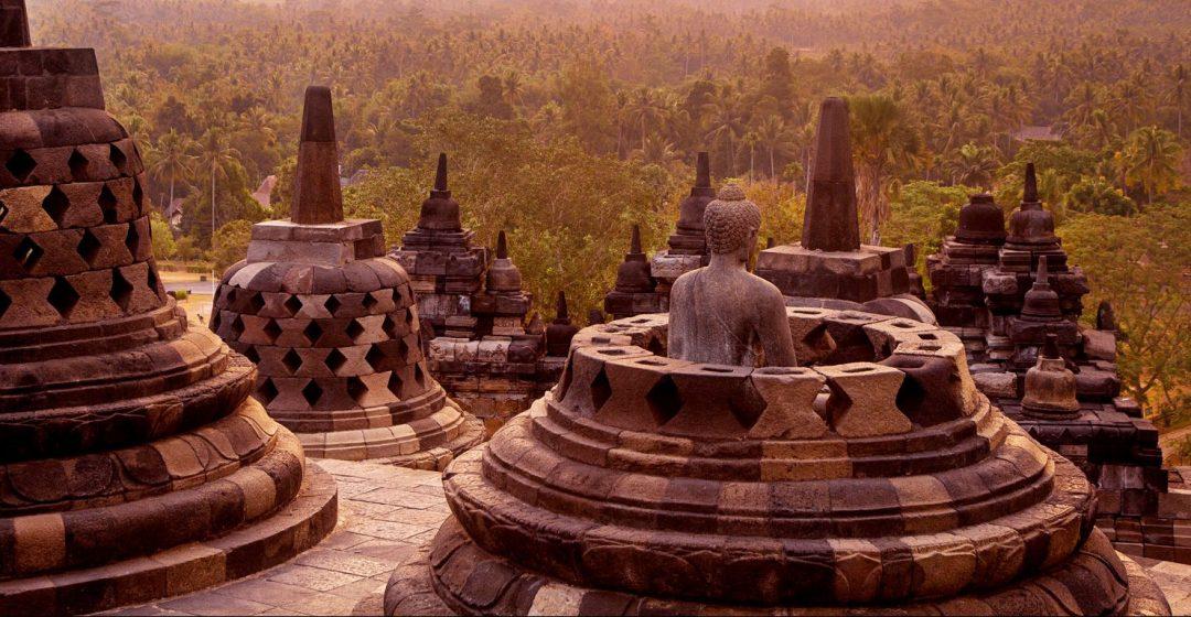Statue and stupas at Borobudur Temple on Java, Indonesia