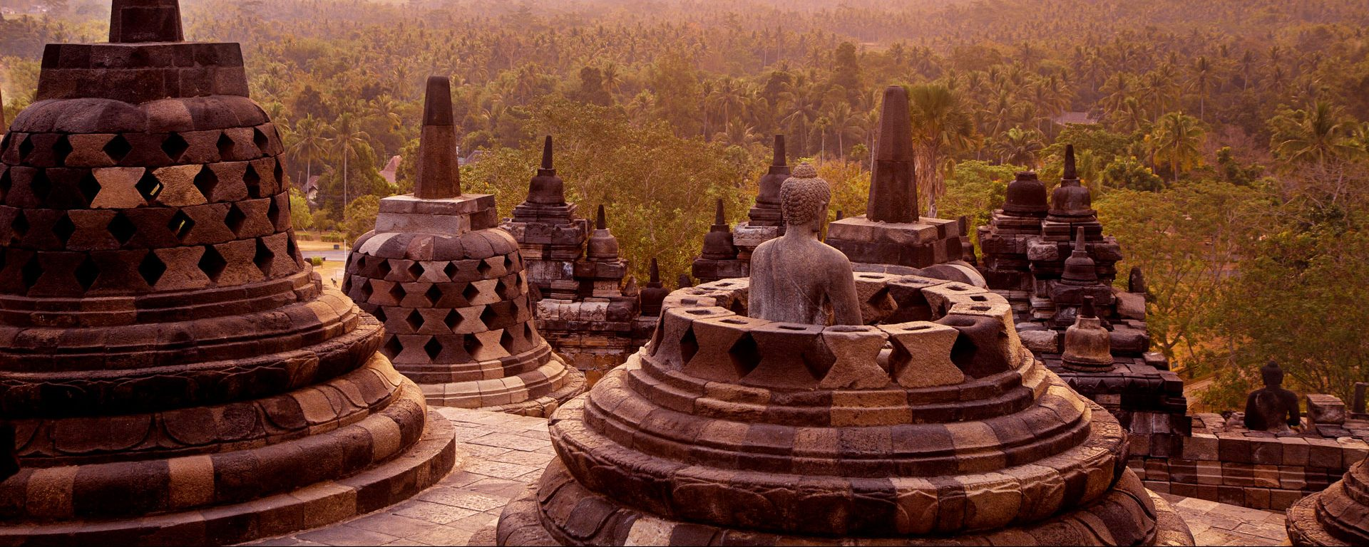 Statue and stupas at Borobudur Temple on Java, Indonesia