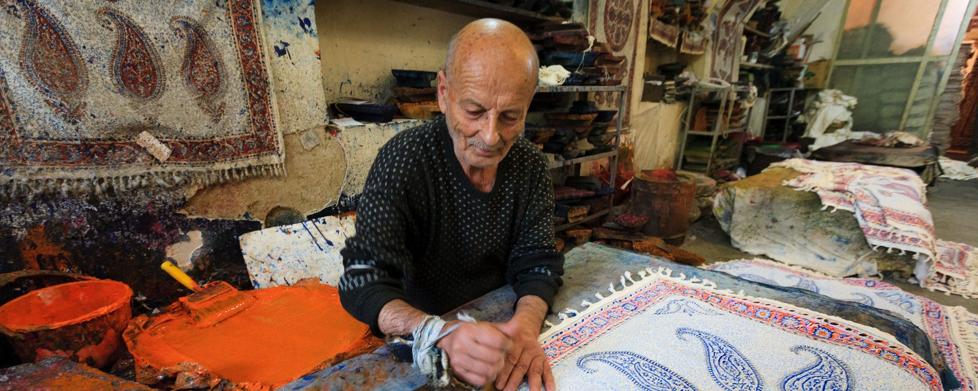 An artist crafts tapestries in his workshop, Iran