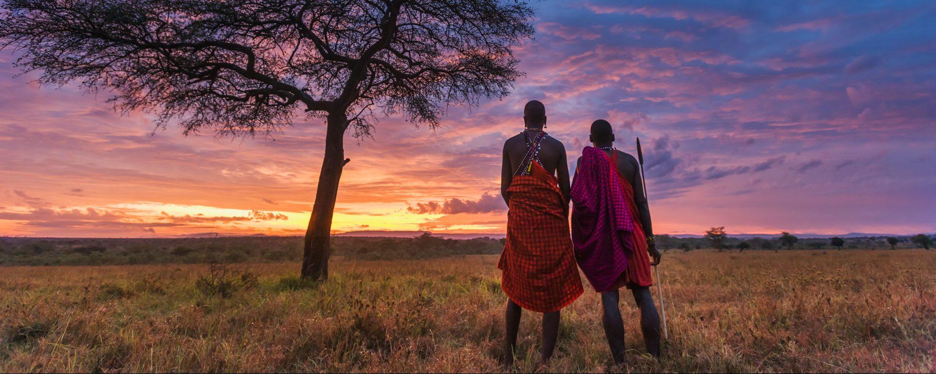 Two Maasai tribesman at dawn in the Masai Mara, Kenya