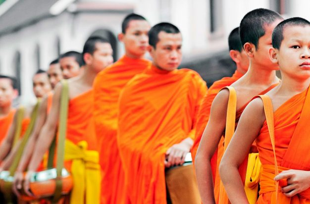 Monks processing for early morning alms in Luang Prabang, Laos