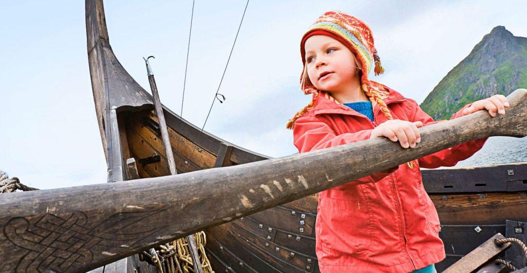 Girl at the oar of a vikingship, Viking museum, Borg, Lofoten, Norway