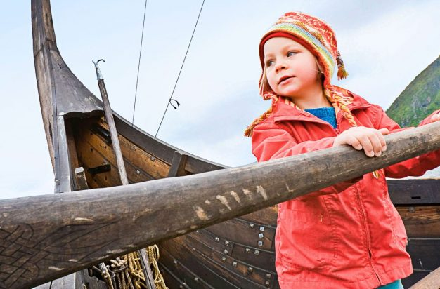 Girl at the oar of a vikingship, Viking museum, Borg, Lofoten, Norway