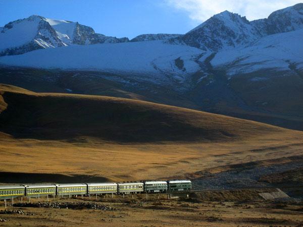 Golden Eagle train driving through mountainous landscape, Silk Road region