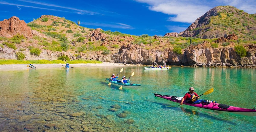 Sea Kayakers in crystalline waters, Honeymoon Cove, Baja, Mexico