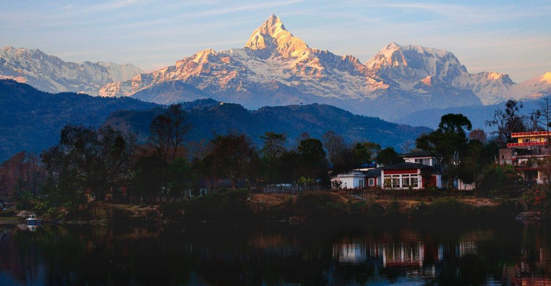 Reflections of the Annapurna Range in Phewa Lake at sunset, Pokhara, Nepal