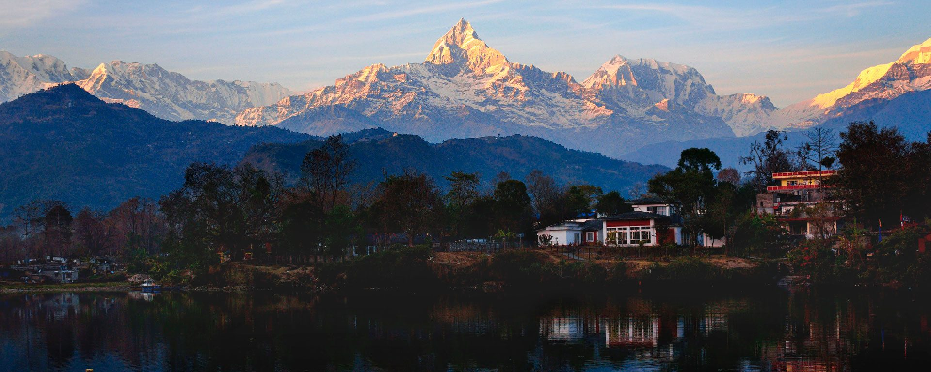 Reflections of the Annapurna Range in Phewa Lake at sunset, Pokhara, Nepal