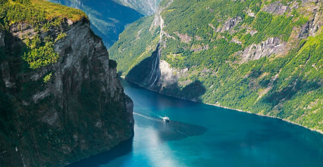 A motorboat glide across Geiranger Fjord, Norway