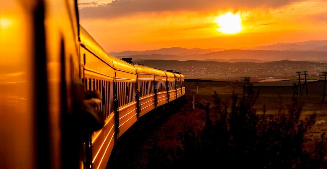 A train rolls along the Trans-Siberian Railway at sunrise, Russia