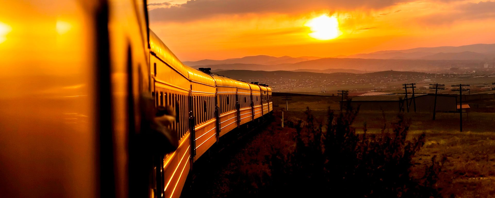 A train rolls along the Trans-Siberian Railway at sunrise, Russia