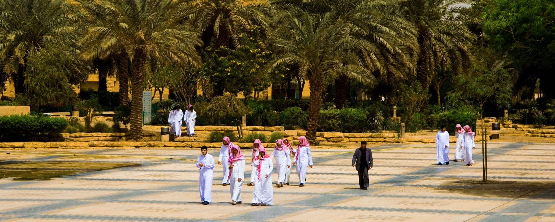 A group of students in the square in front at the National Museum, Riyad, Saudi Arabia
