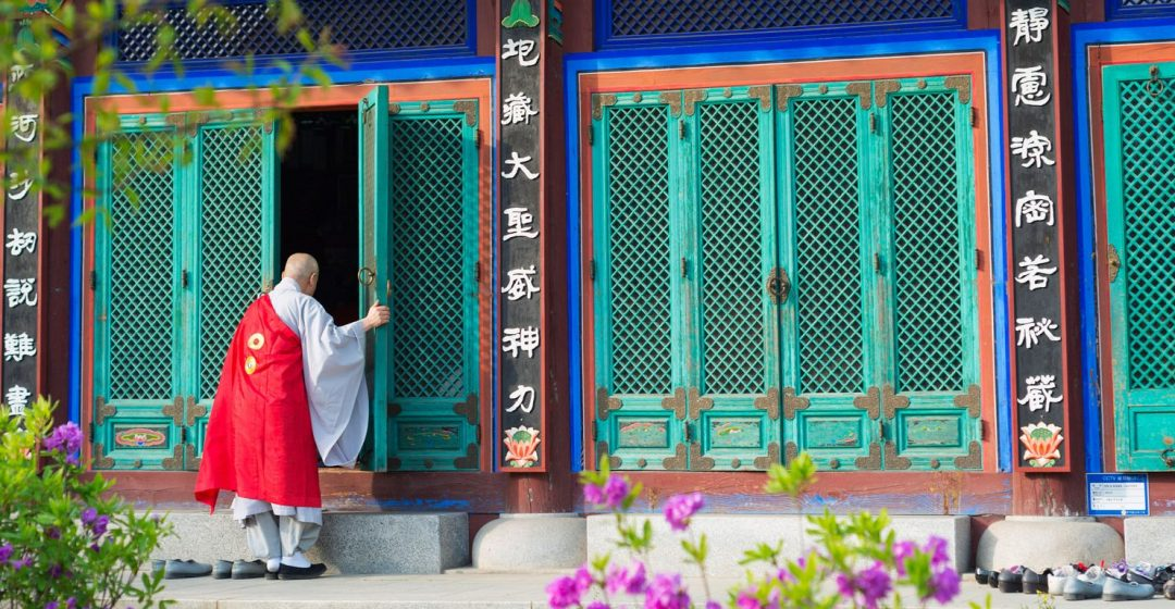 Priest outside Buddhist temple in Seoul, South Korea