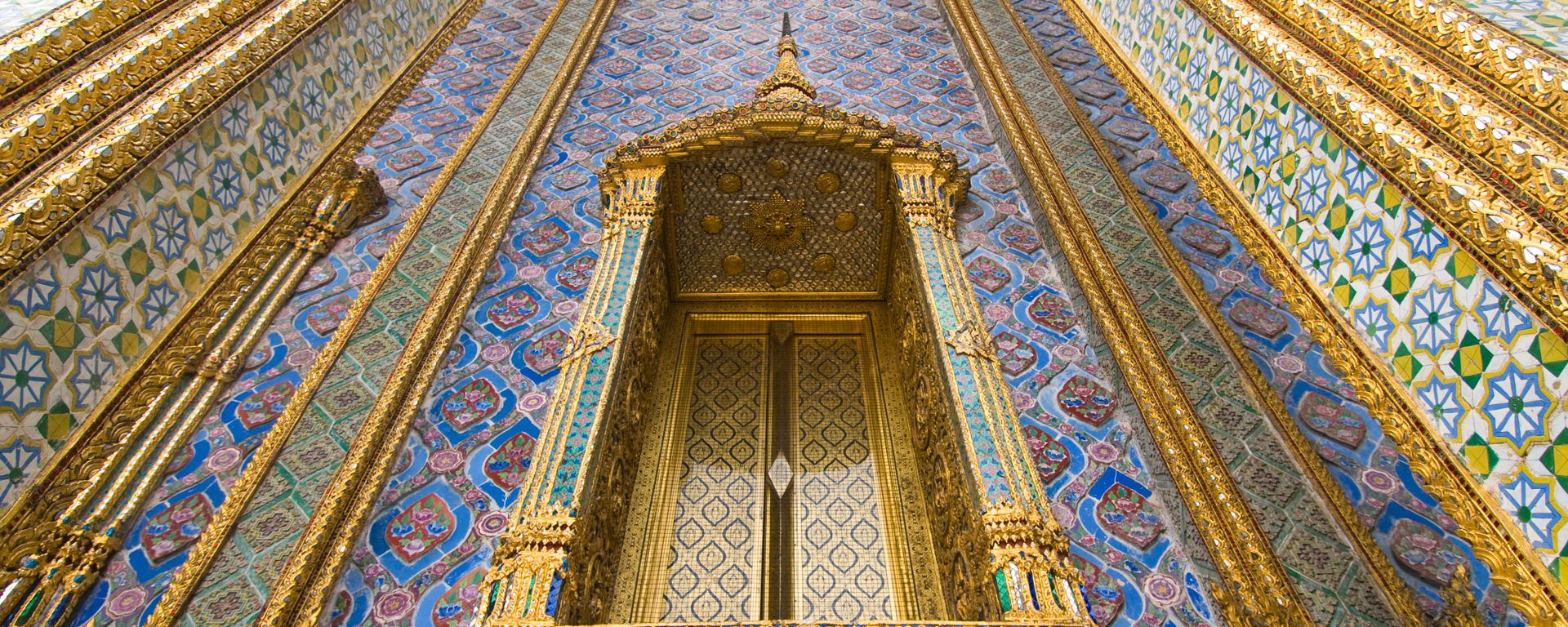 Detail of window and columns of Wat Phra Kaew in the Royal Palace complex in Bangkok, Thailand