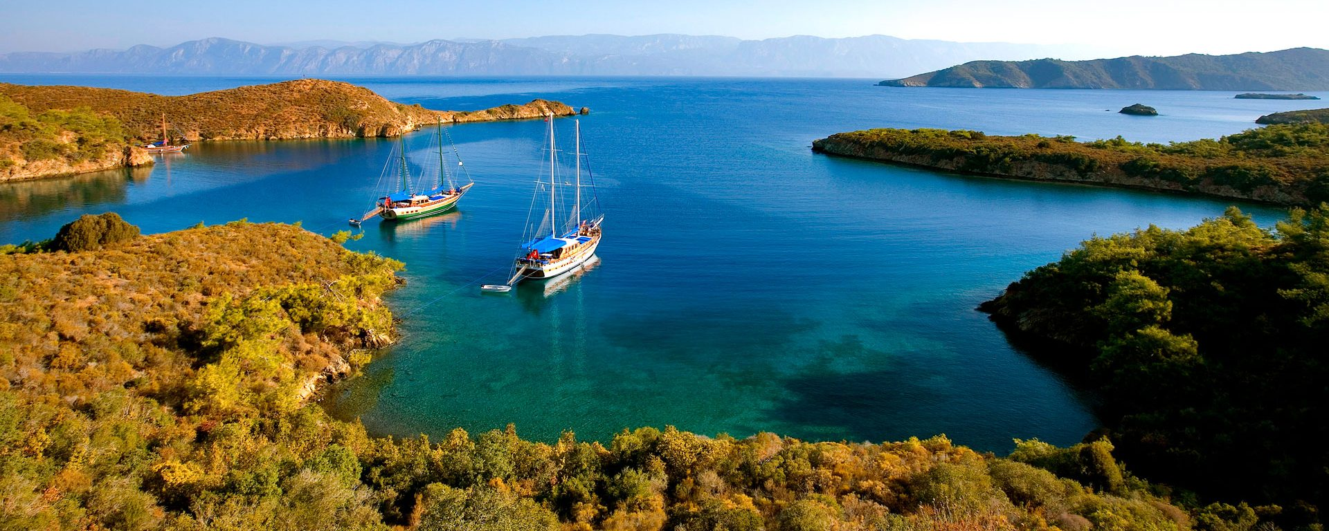 A gulet (traditional Turkish sailing boat) mooring at Tuzla Bay on the Aegean coast, Turkey