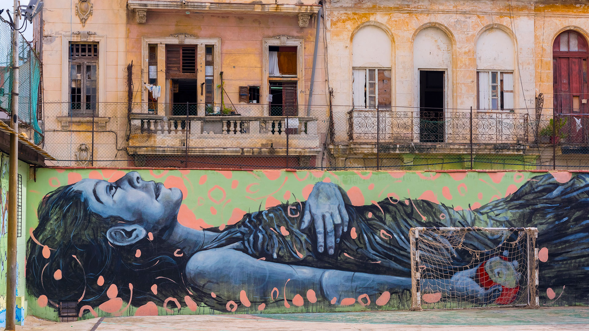 Graffiti painting of a reclining woman in a playground, Old Havana, Cuba