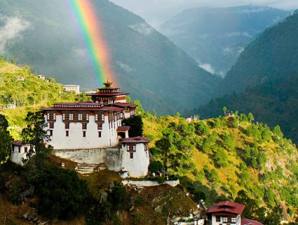 Lhuentse dzong with rainbow in eastern Bhutan