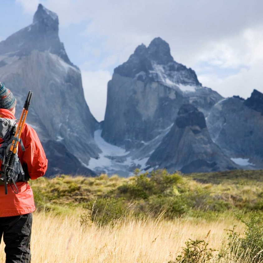 A hiker in front of the iconic Cuernos del Paine, Patagonia