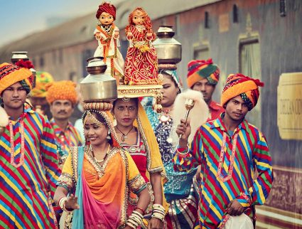 Colorfully dressed locals welcome the Deccan Odyssey train in Jaipur, India with GeoEx