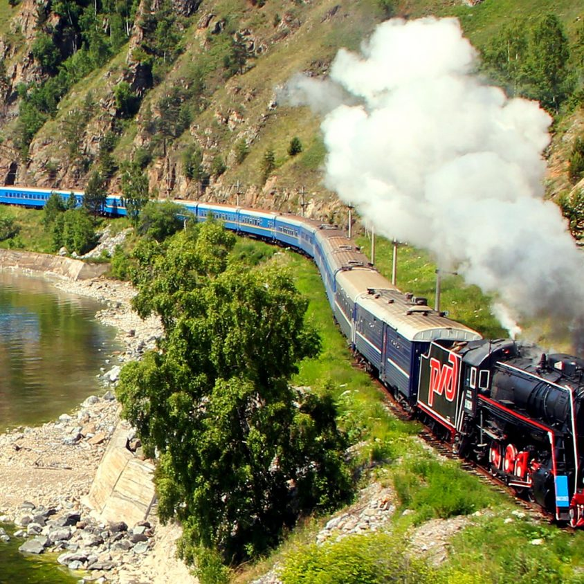 Aerial view of the Golden Eagle cruising past Lake Baikal, Trans-Siberain train journeys with GeoEx