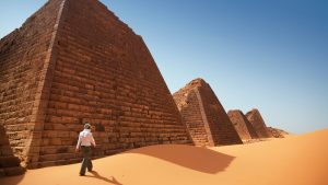 A woman explores the ancient Nubian pyramids of Begrawiya, Sudan