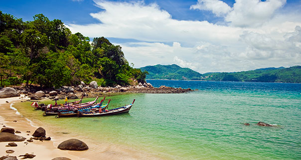 Longtail boats and bay scene in Phuket, Thailand