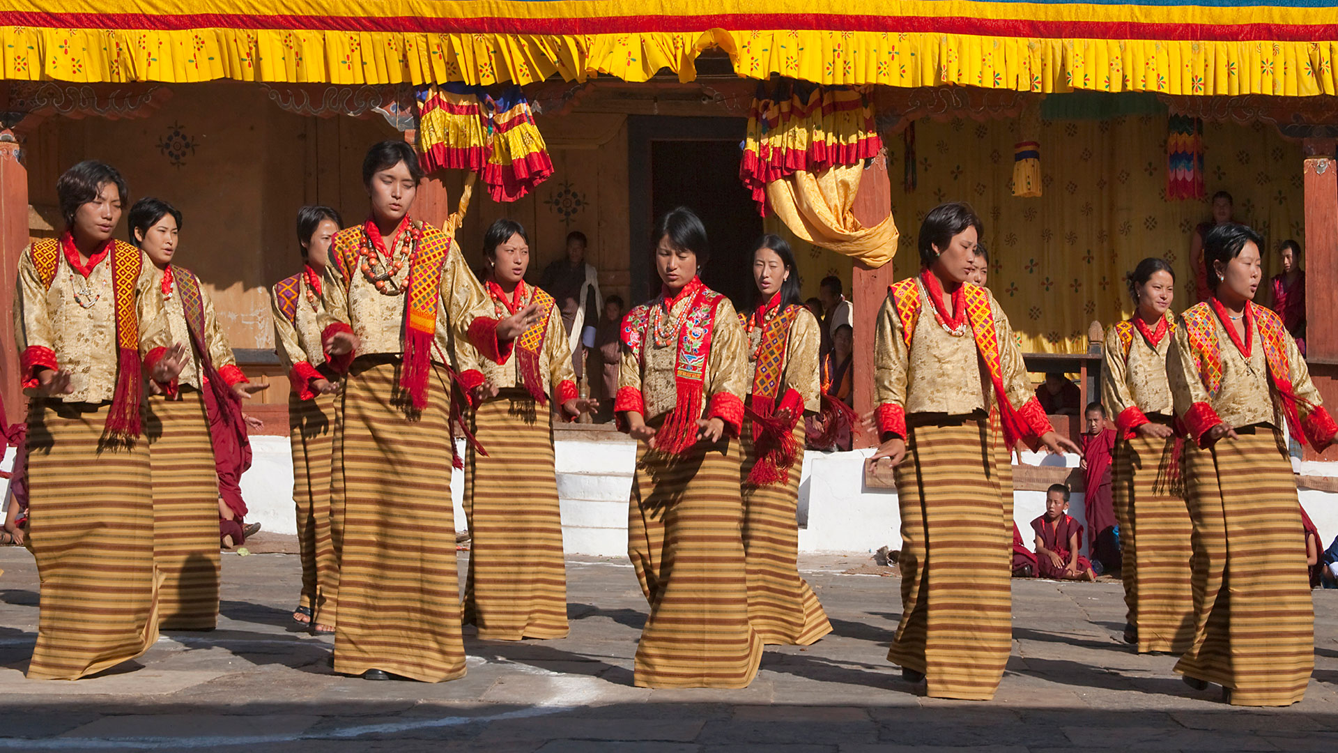 Female dance performance at dzong in Bhutan