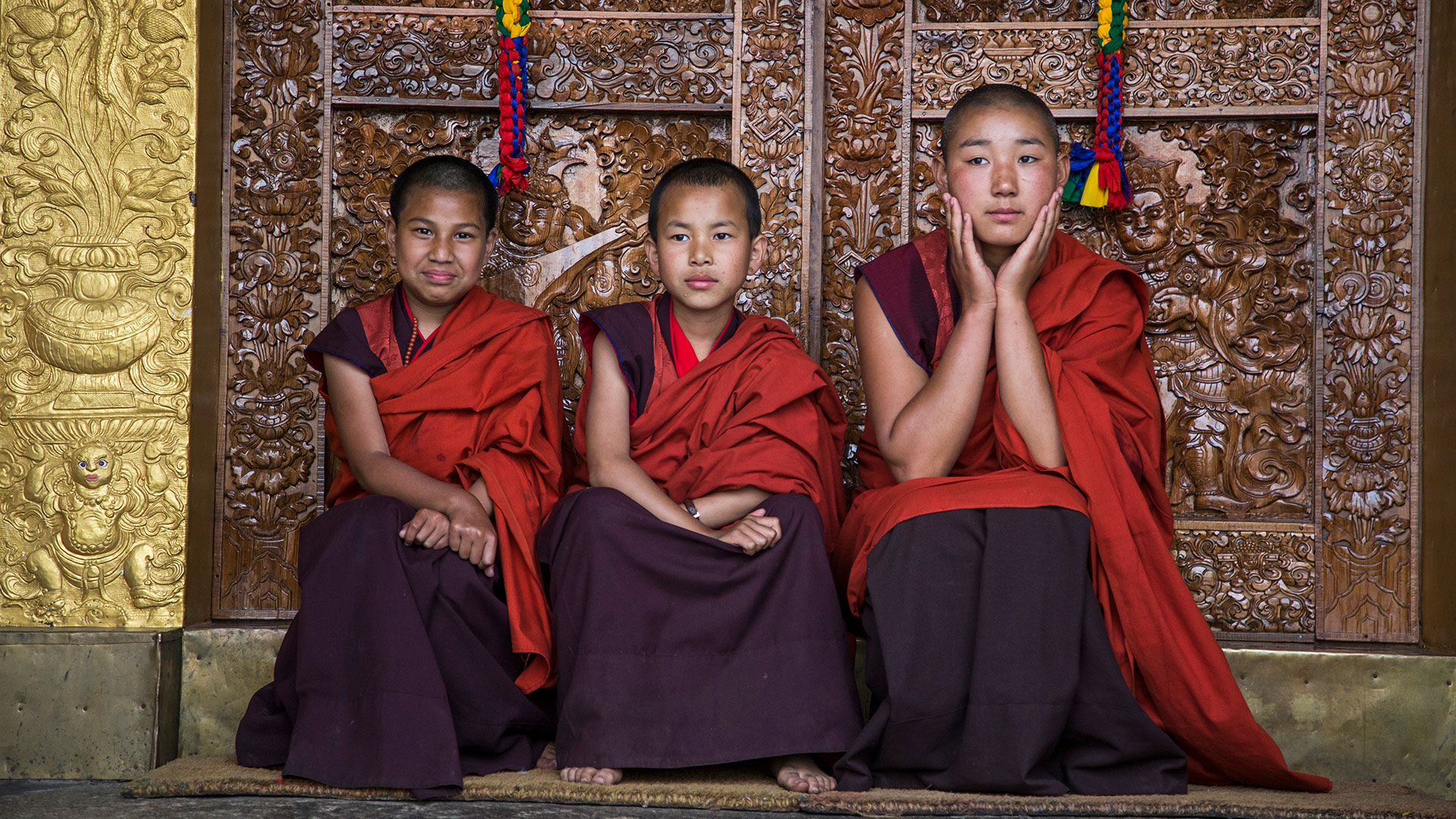 Young nuns outside a nunnery in Punakha, Bhutan