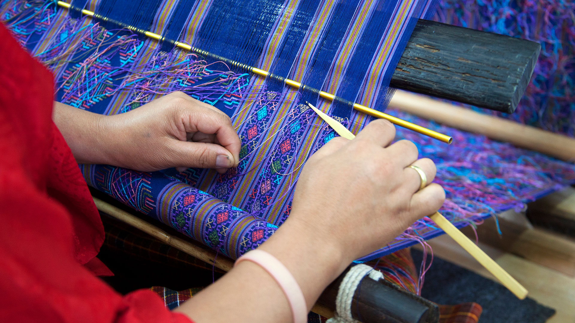 Textile weaver at loom in Thimphu, Bhutan