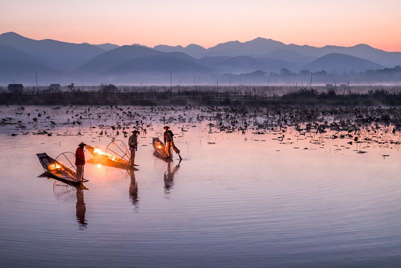 Traditional Intha fisherman at dusk on Inle Lake, Myanmar
