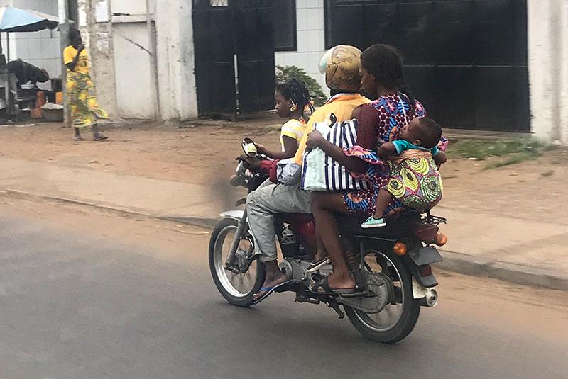 Family on a motorbike in Cotonou, Benin