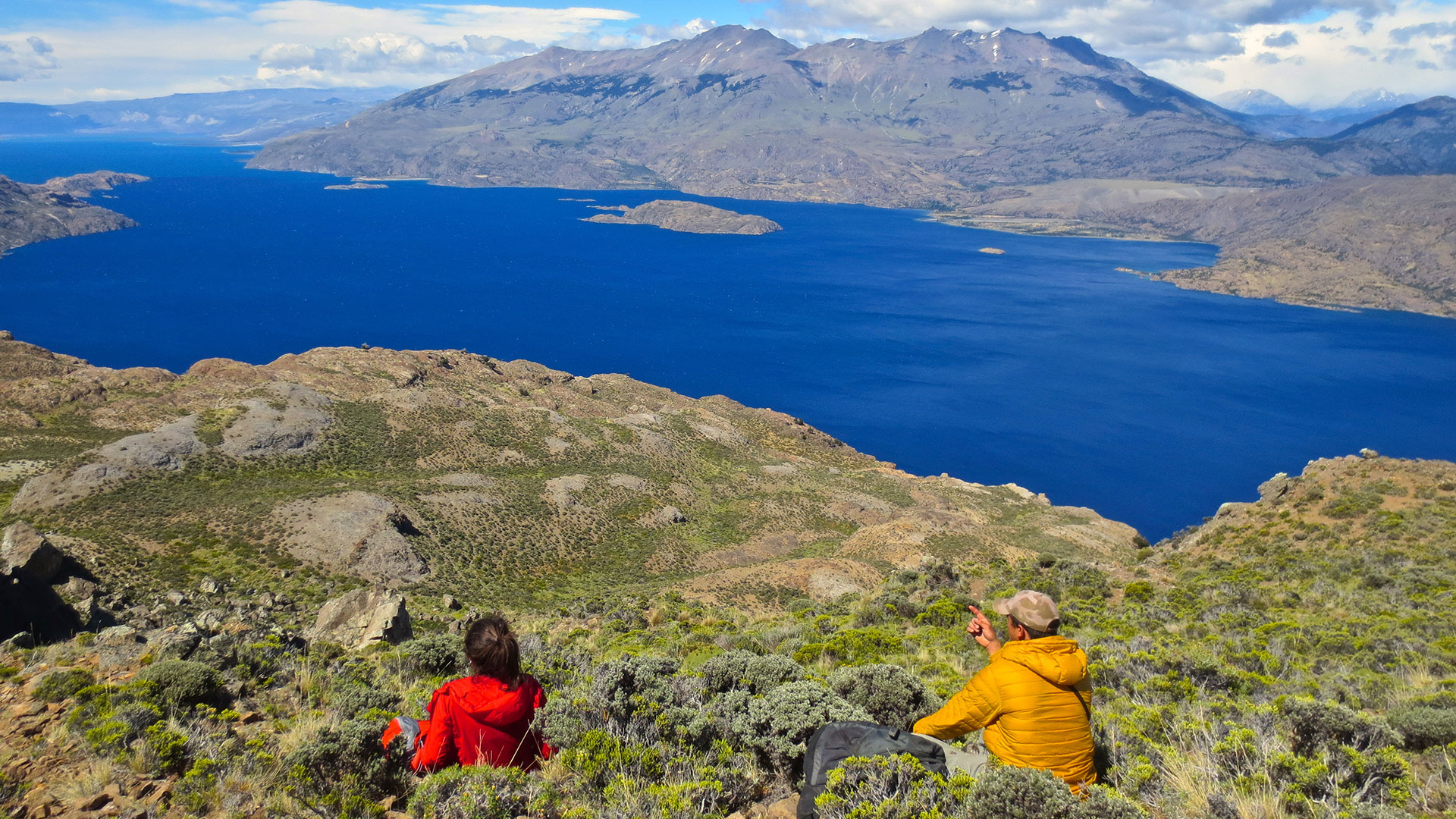 Hikers overlooking Lake Cochrane in Patagonia National Park, Chile