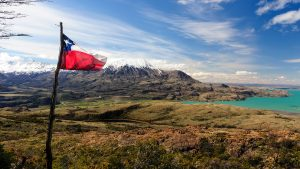 Chilean flag overlooking Lago General Carrera in Puerto Ibanez, Chile