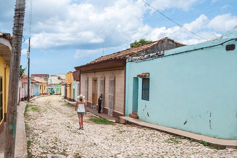 Women walking through small town in Viñales Valley, Cuba.